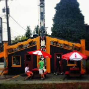The Red Mill Totem House. The delicious food is inside.