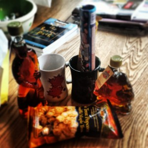 Canadian presents, including maple syrup, maple candies, Coffee Crisp, Smarties, maple popcorn and other mapley things.