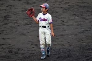 Cute little Japanese kids just playing some ball on a big-time field.