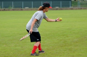 Outfield coach Patricia Landry with the racquet and tennis balls for the drill.