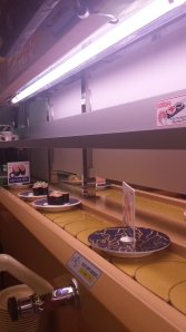 Conveyor-belt sushi, take what you want and leave the rest.